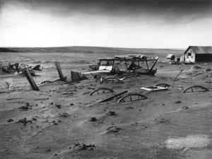 """Dust Bowl - Dallas, South Dakota 1936"" by Sloan (?) - United States Department of Agriculture; Image Number: 00di0971 (original link now dead). Licensed under Public Domain via Wikimedia Commons - http://commons.wikimedia.org/wiki/File:Dust_Bowl_-_Dallas,_South_Dakota_1936.jpg#/media/File:Dust_Bowl_-_Dallas,_South_Dakota_1936.jpg"